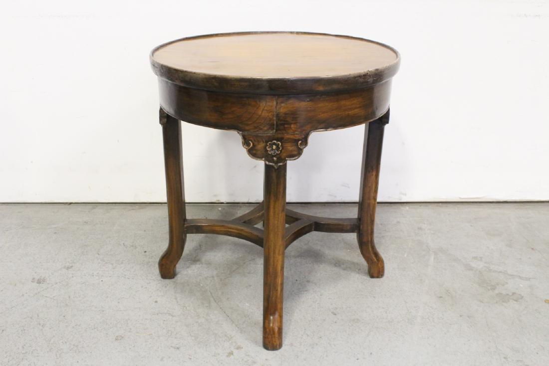 A walnut round table - 10