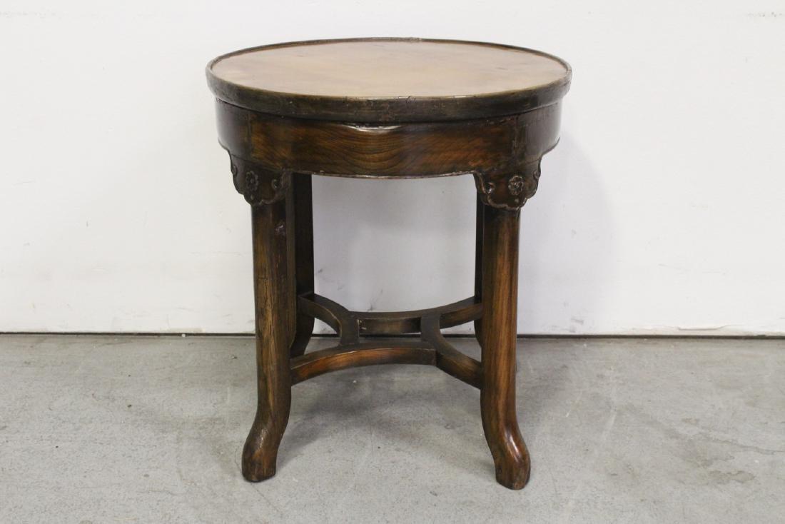 A walnut round table