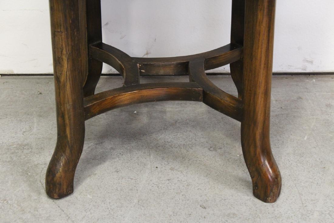A walnut round table - 3
