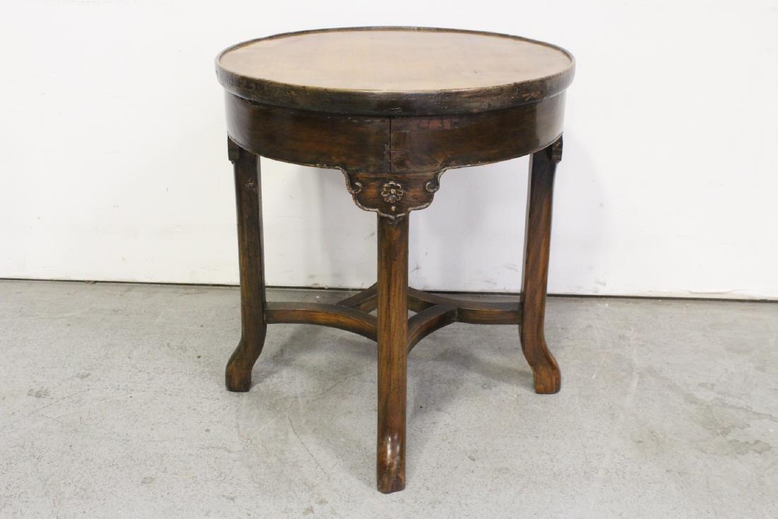 A walnut round table - 4