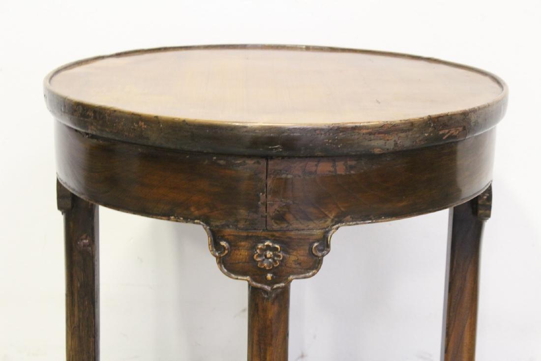 A walnut round table - 5