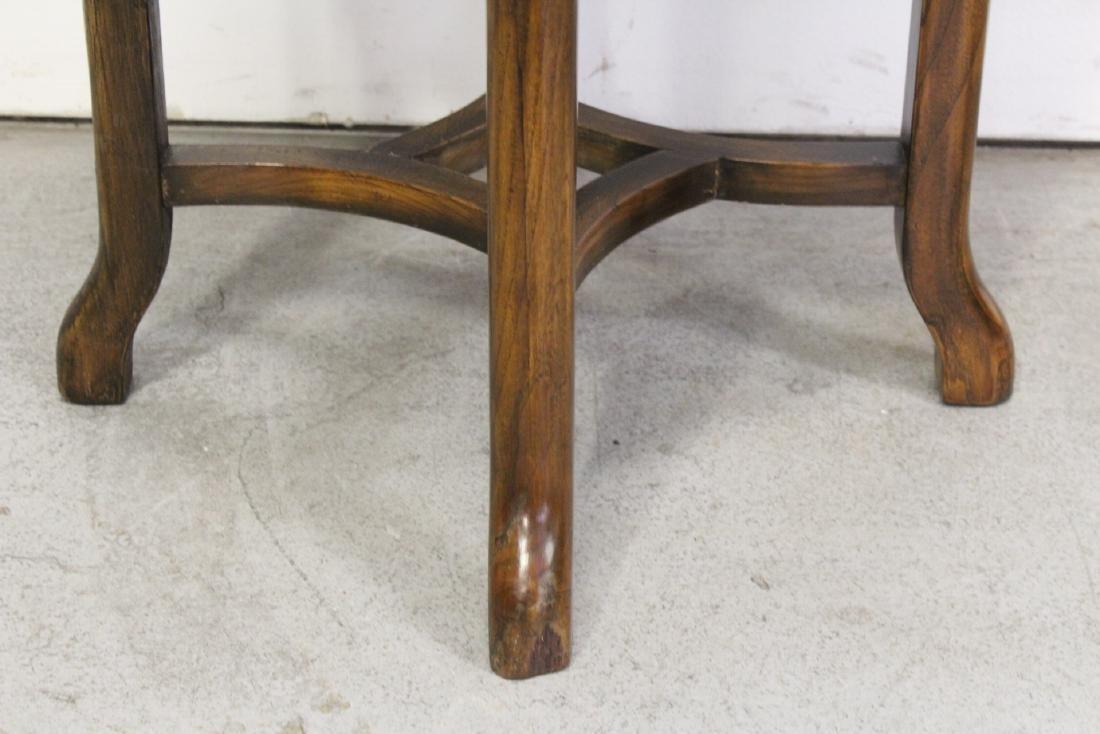A walnut round table - 6