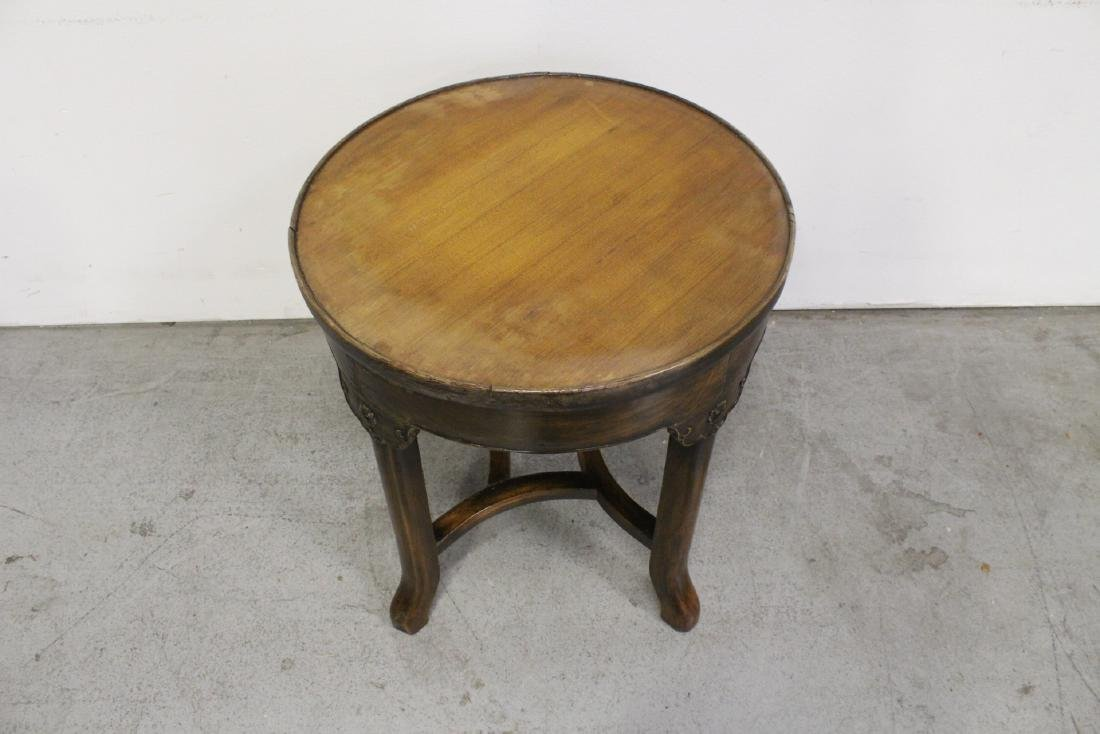 A walnut round table - 8