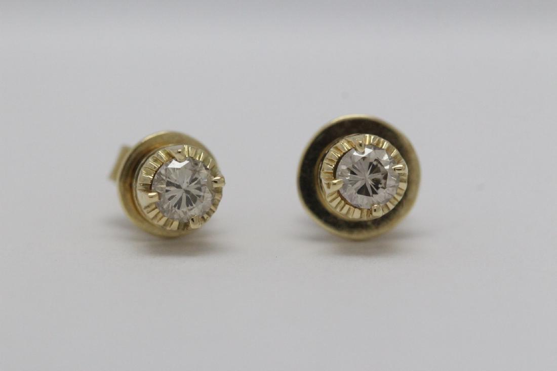 Pair 14K Y/G diamond stud earrings