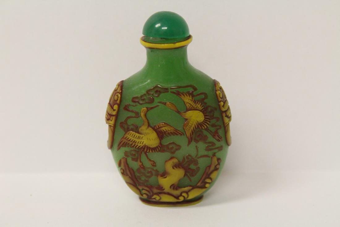 An overlay green Peking glass snuff bottle