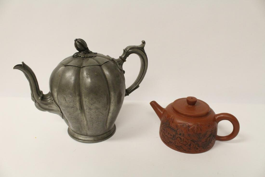 A pewter teapot and a Chinese Yixing teapot