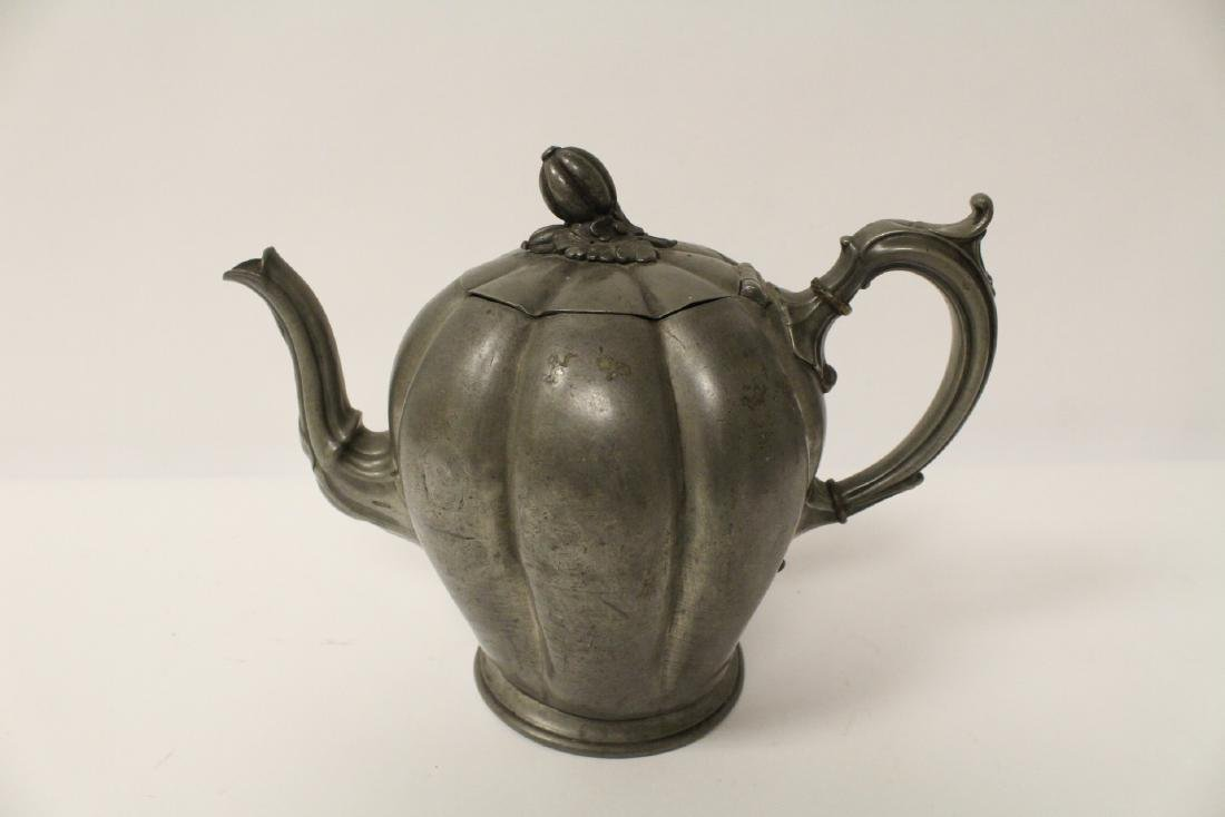 A pewter teapot and a Chinese Yixing teapot - 2