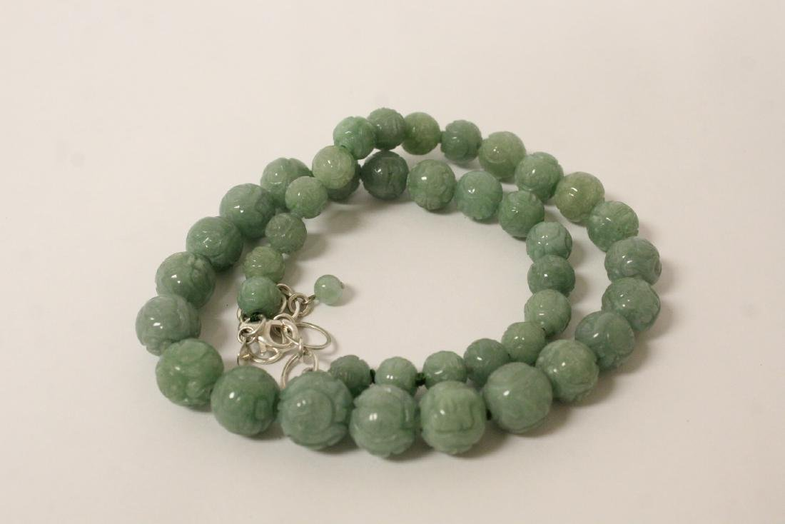 Chinese carved jadeite bead necklace w/ silver clasp - 10