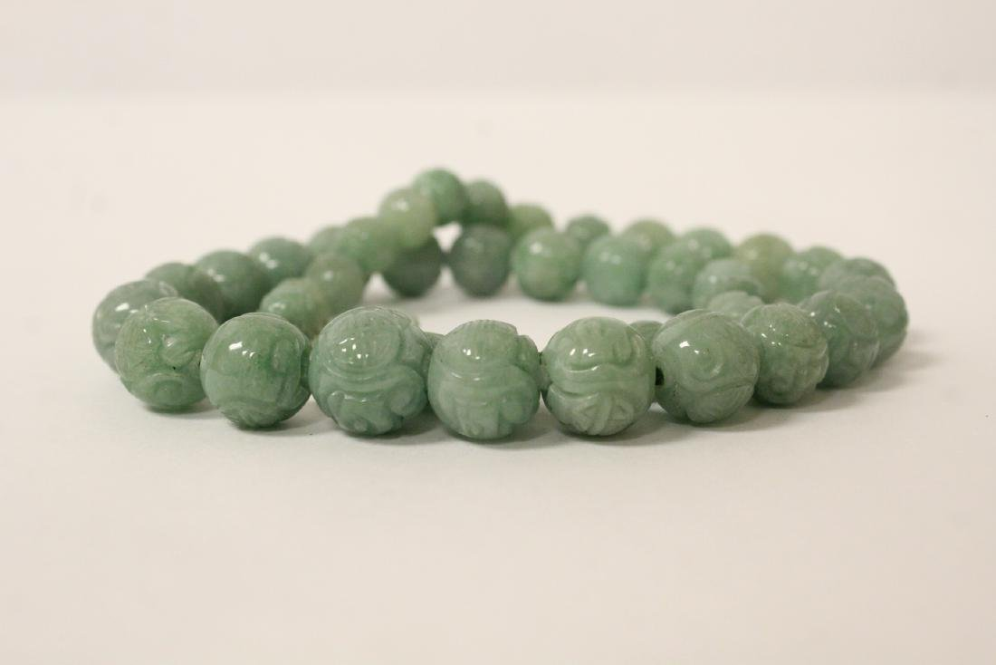 Chinese carved jadeite bead necklace w/ silver clasp - 9