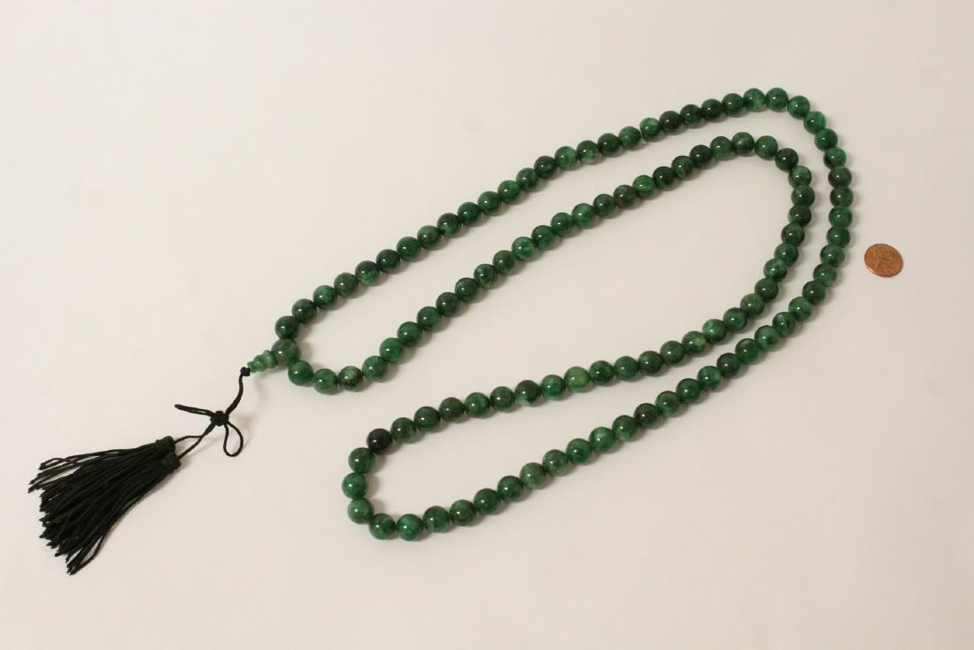 A long jade like stone bead necklace