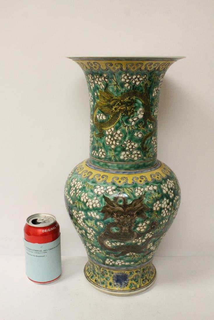 Chinese green background famille rose vase