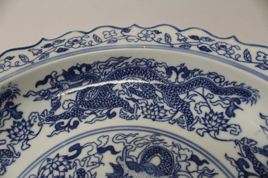 A large blue and white porcelain plate - 8