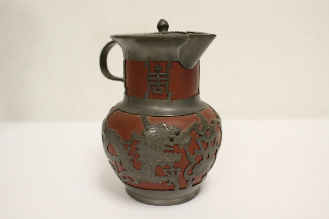 A heavy brass vase, a teapot, 4 irons - 3