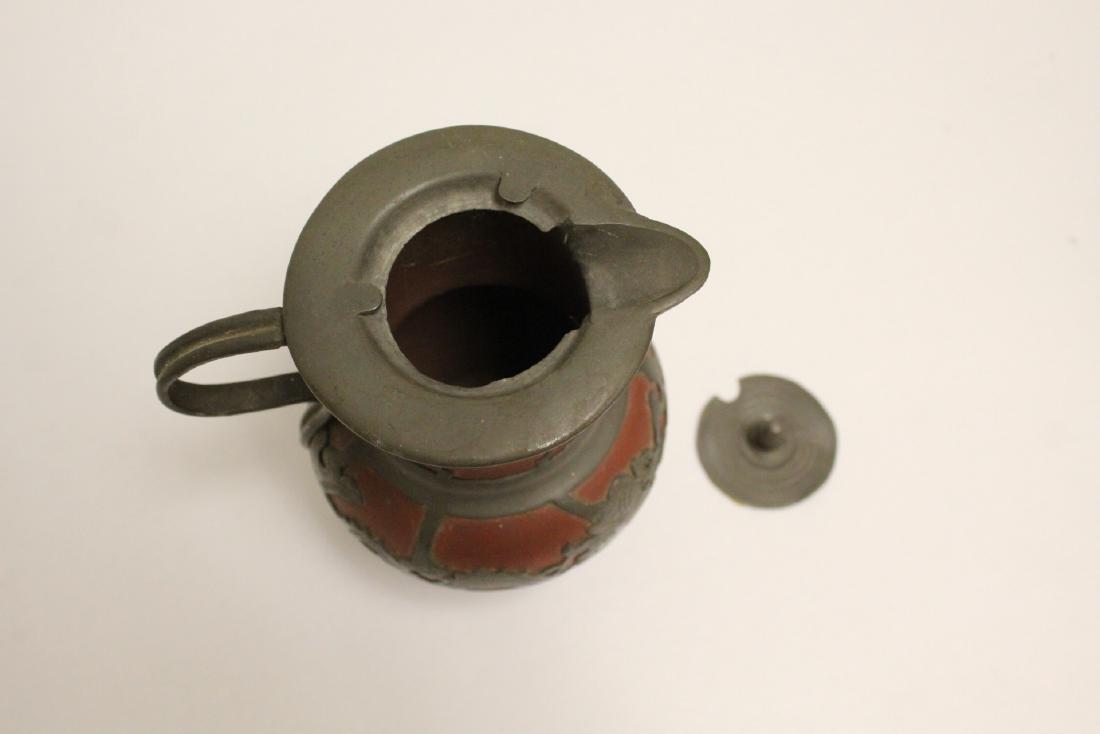 A heavy brass vase, a teapot, 4 irons - 4