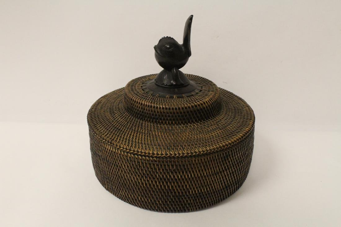 antique Nantucket basket with wood carving finial