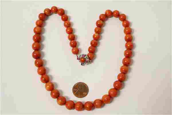 A blood red coral bead necklace