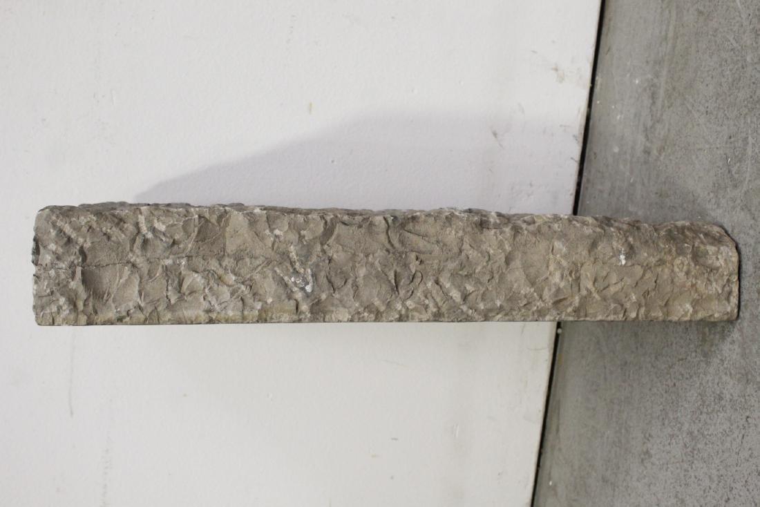 A stone plaque - 7