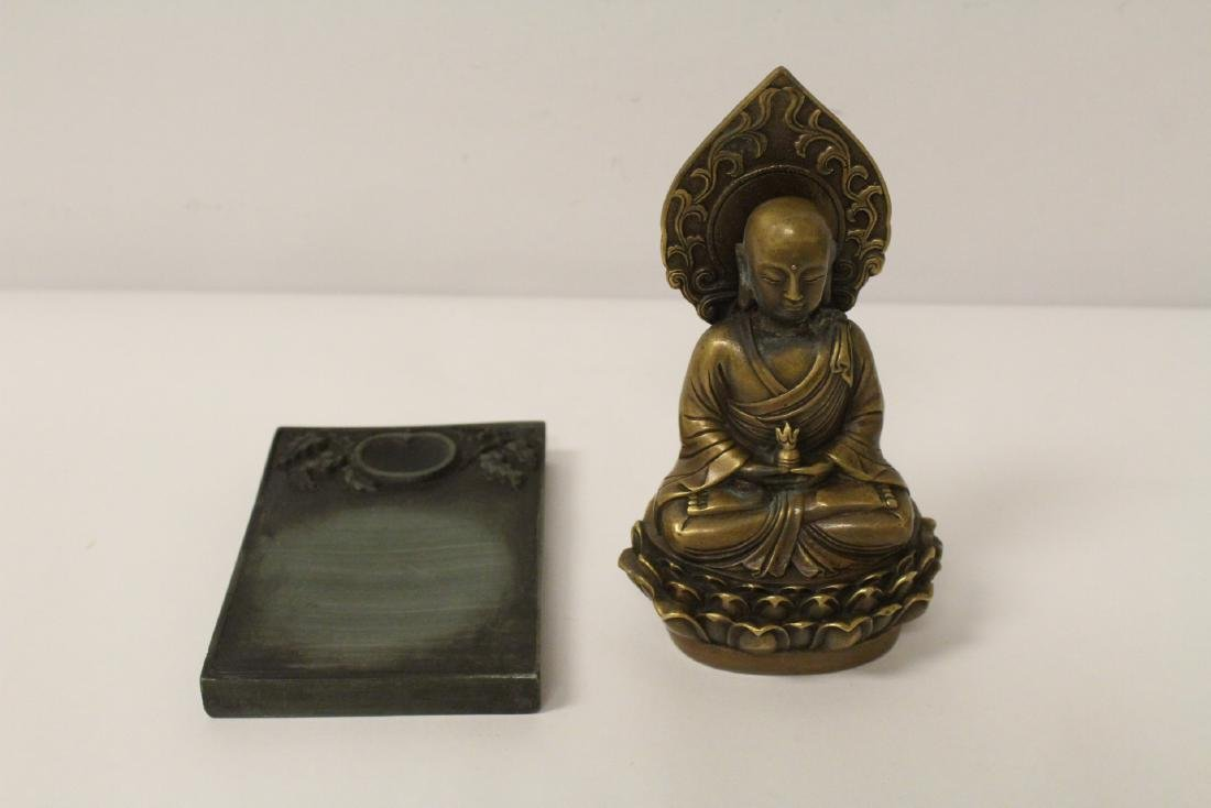 Chinese bronze Buddha statue and an inkstone