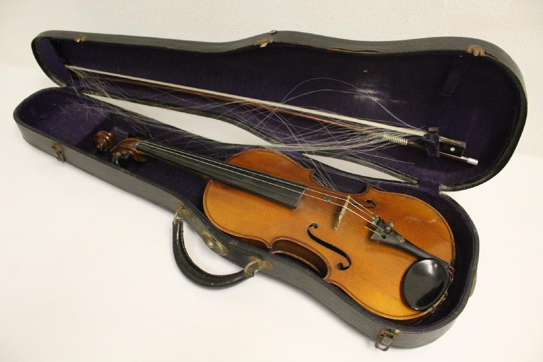 Antique violin with bow