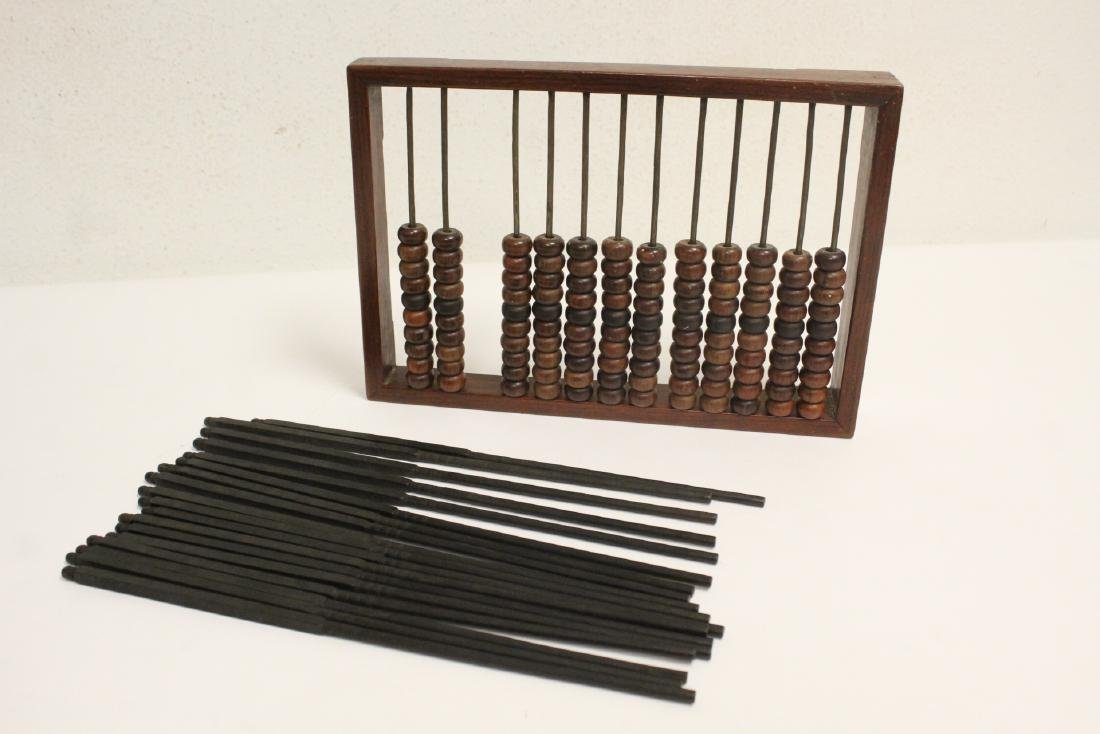 Chinese huanghuali wood abacus and 9 pairs chopsticks