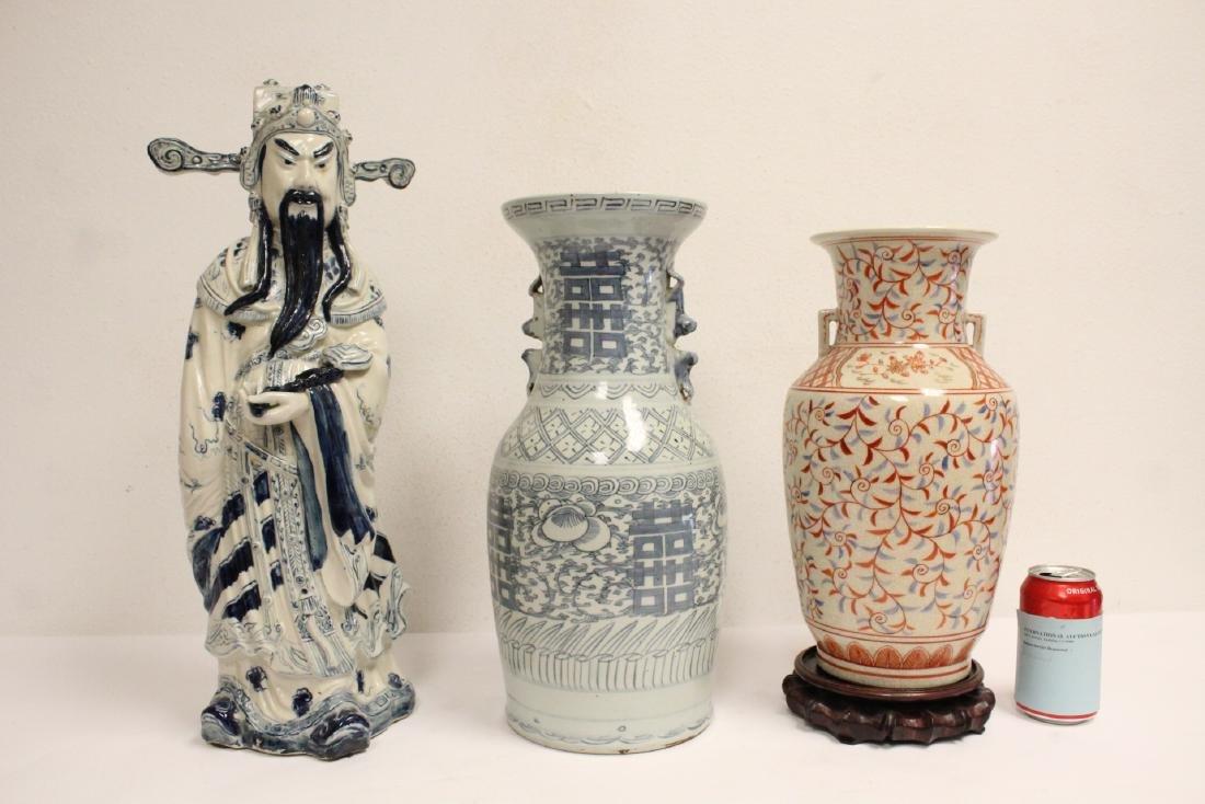 2 porcelain vase,s, and a figure