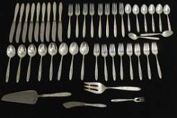 Serving for 8 sterling dinner set by Towle