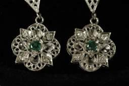 Pair 14K W/G emerald diamond earrings