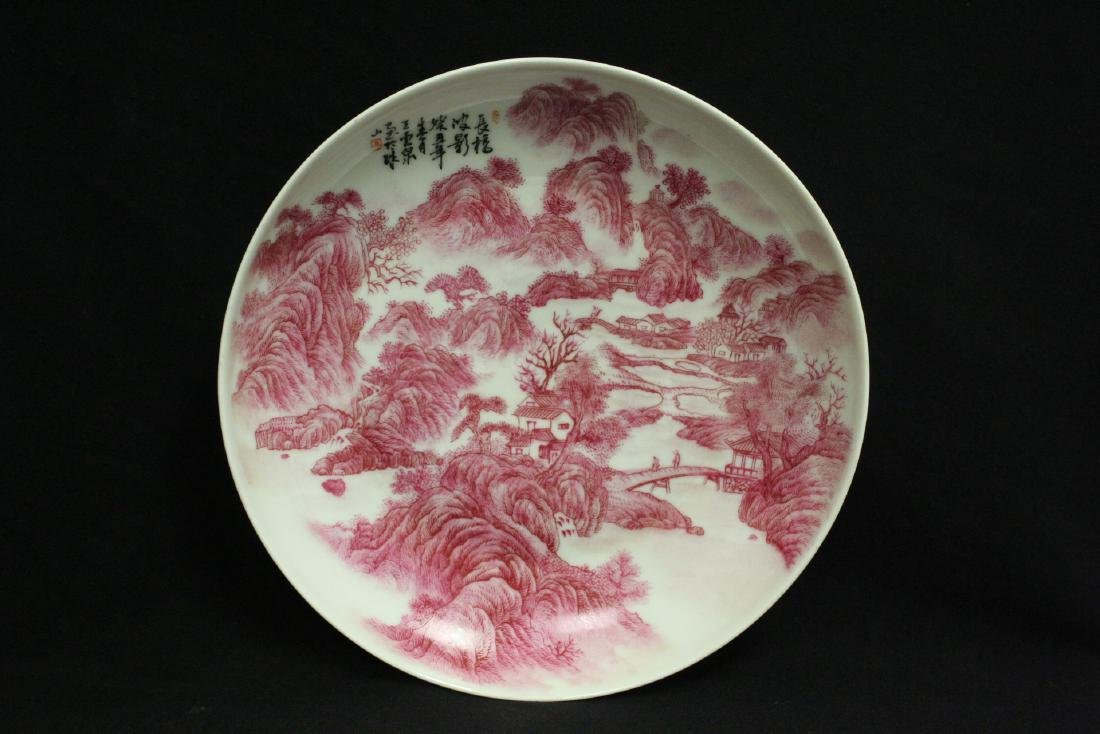 red and white porcelain plate with calligraphy