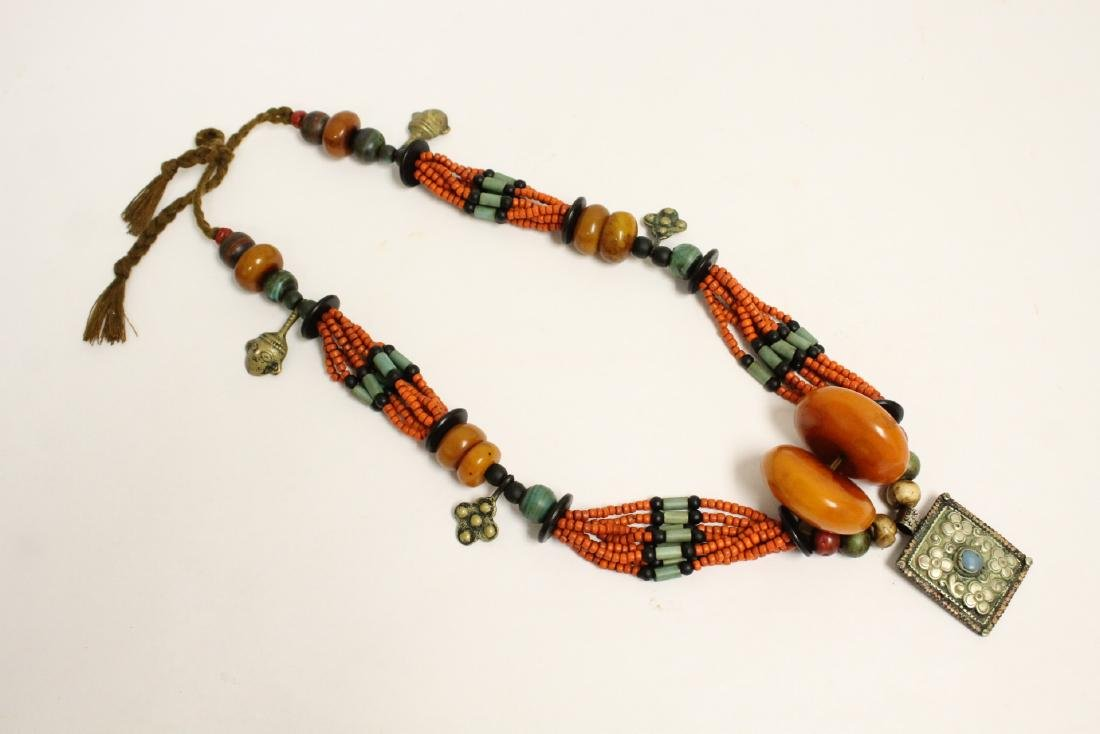 An amber like and coral like necklace
