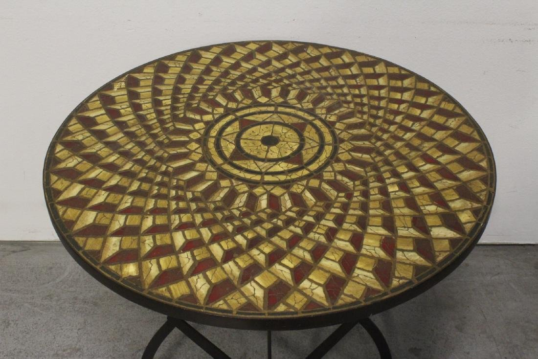 A table with cast iron base and beautiful tile top - 10