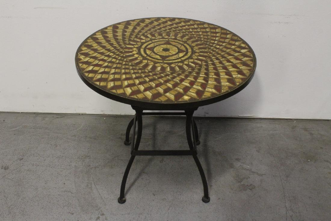 A table with cast iron base and beautiful tile top