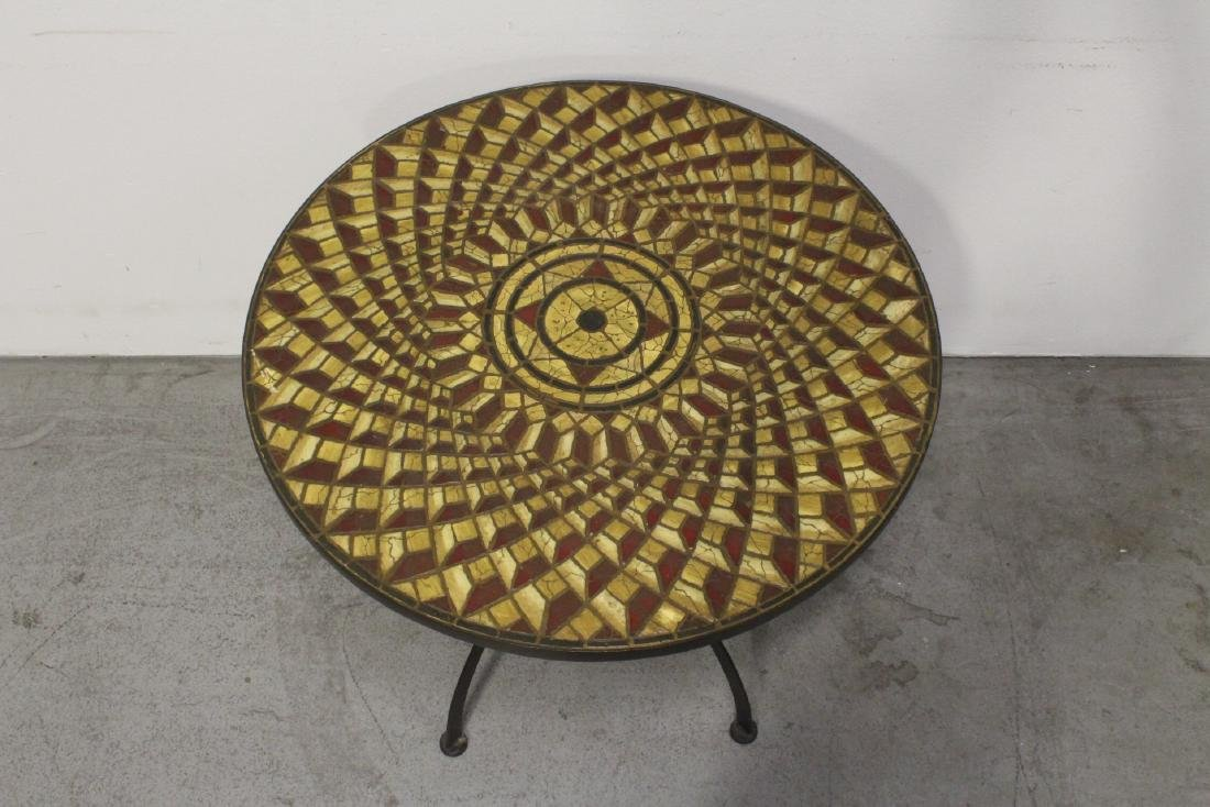 A table with cast iron base and beautiful tile top - 2