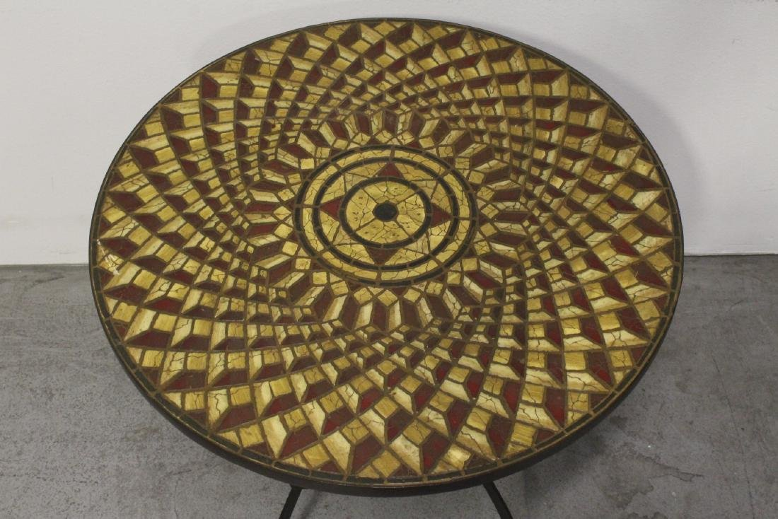 A table with cast iron base and beautiful tile top - 3