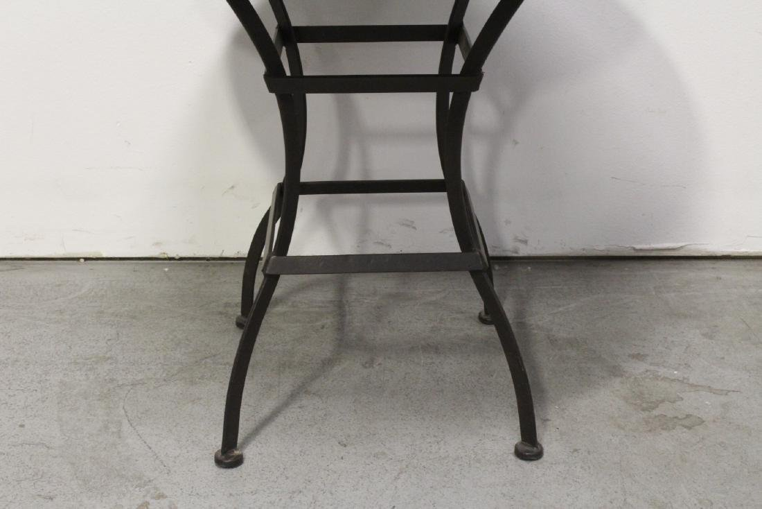 A table with cast iron base and beautiful tile top - 6