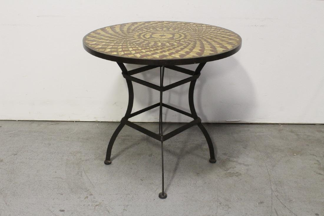 A table with cast iron base and beautiful tile top - 7