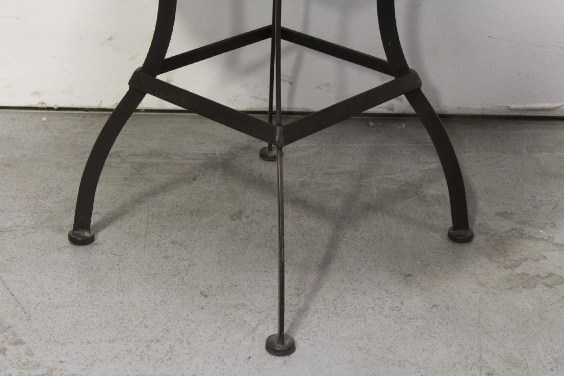A table with cast iron base and beautiful tile top - 8