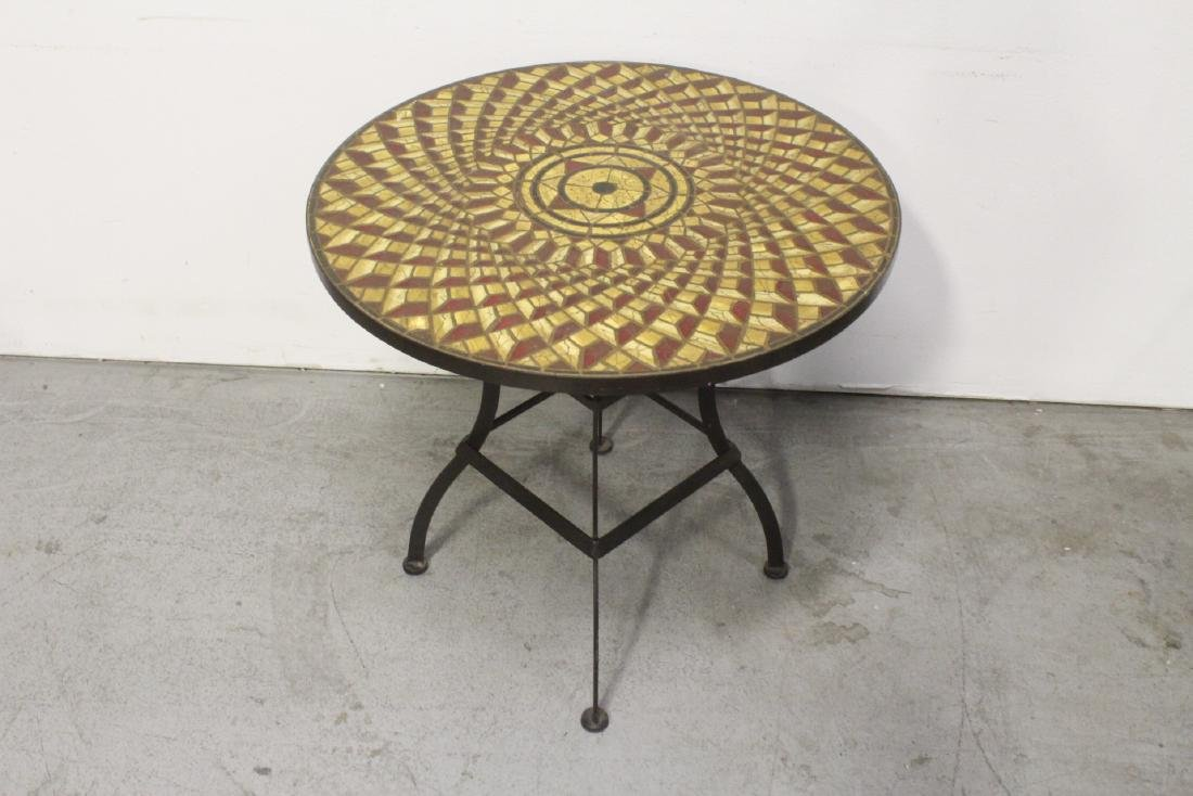A table with cast iron base and beautiful tile top - 9