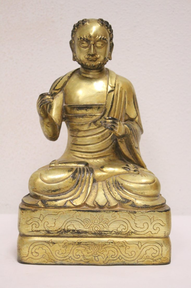 A fine Chinese gilt bronze sculpture of deity
