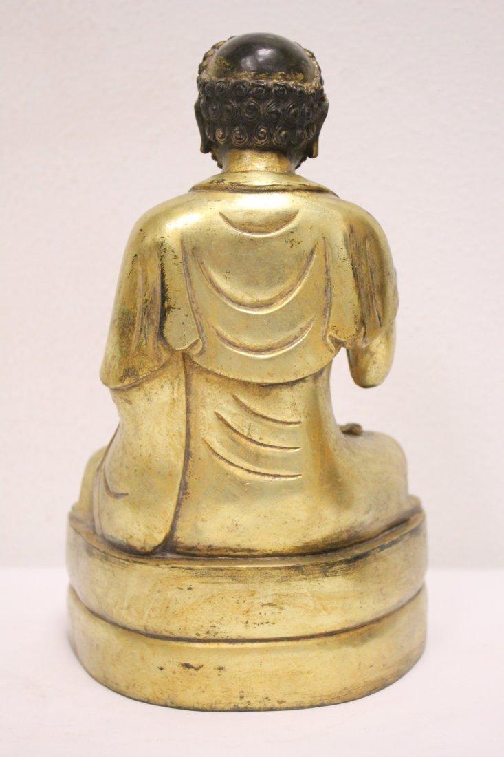A fine Chinese gilt bronze sculpture of deity - 3