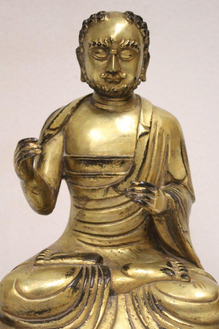 A fine Chinese gilt bronze sculpture of deity - 6