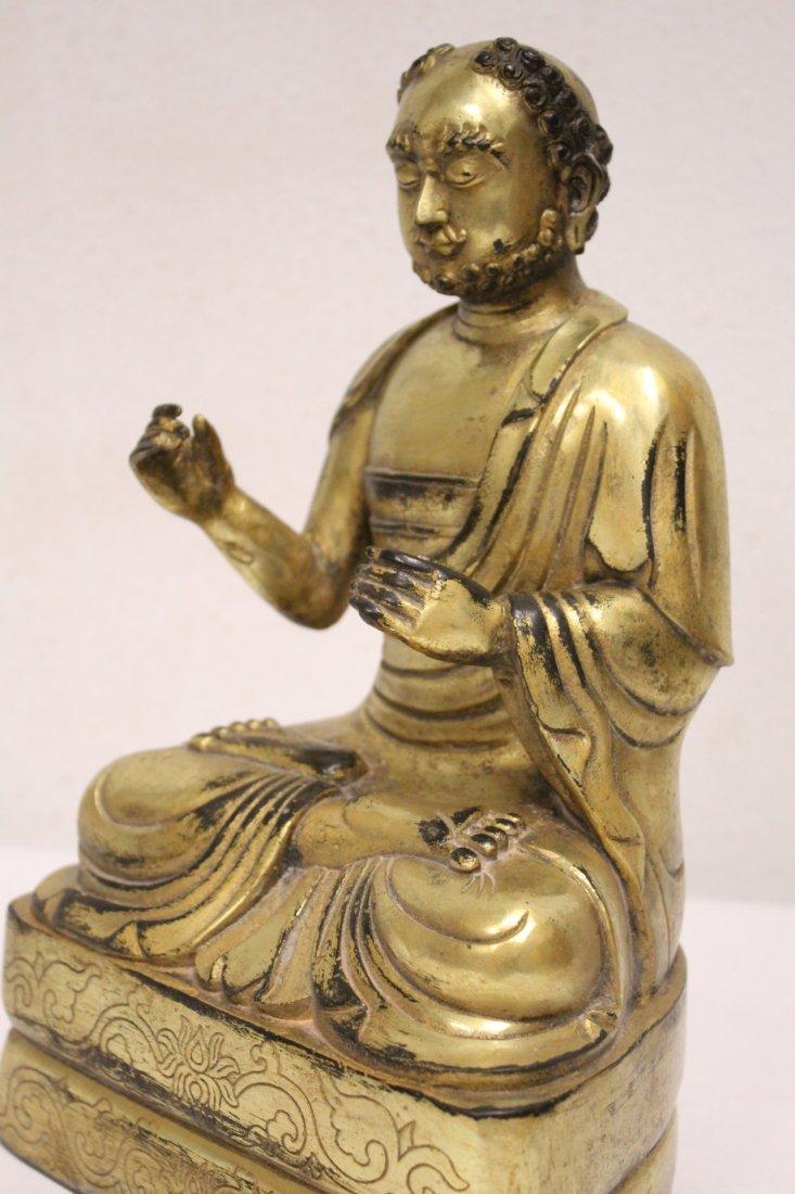 A fine Chinese gilt bronze sculpture of deity - 8