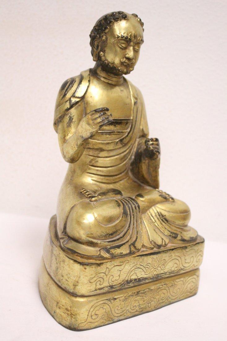 A fine Chinese gilt bronze sculpture of deity - 9