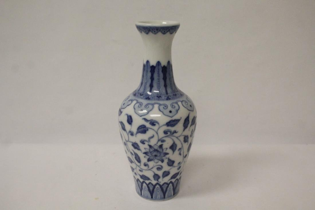 A small Chinese vintage blue and white vase