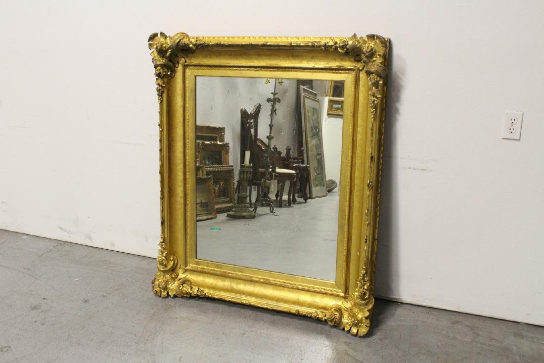 A beautiful antique gilt wood large mirror