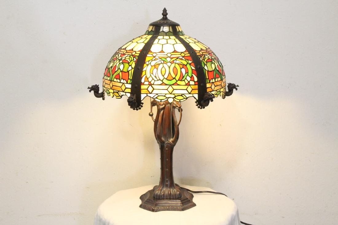 bronze based lamp with leaded glass shade