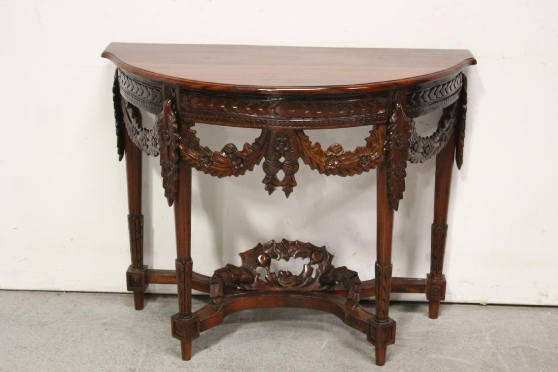 A finely carved Chinese rosewood console table