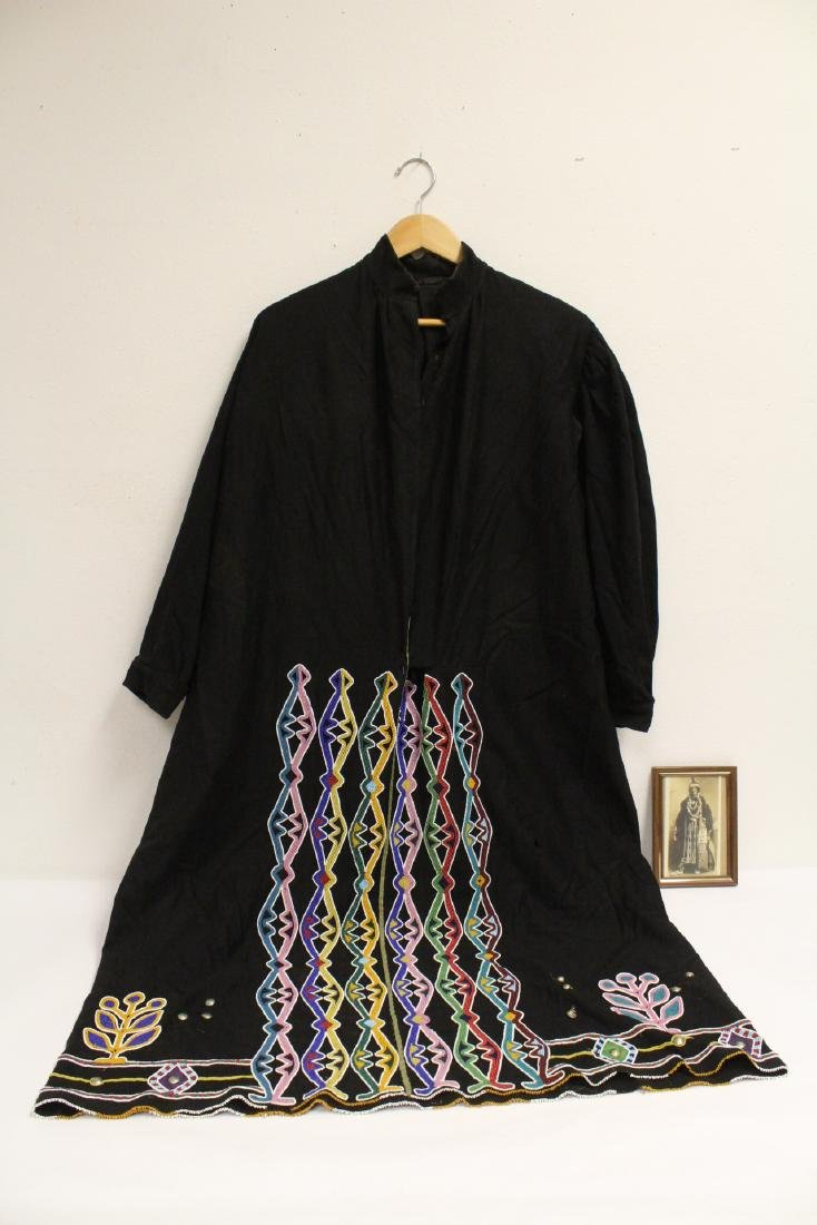 A Long black robe with bead decoration