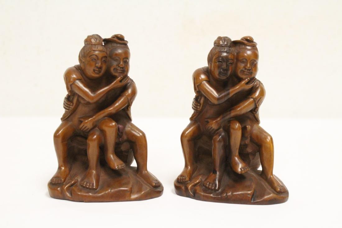 2 huangyang wood carved figures