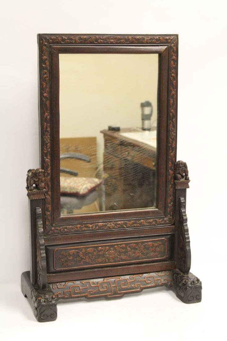 rosewood framed mirror with carved stand