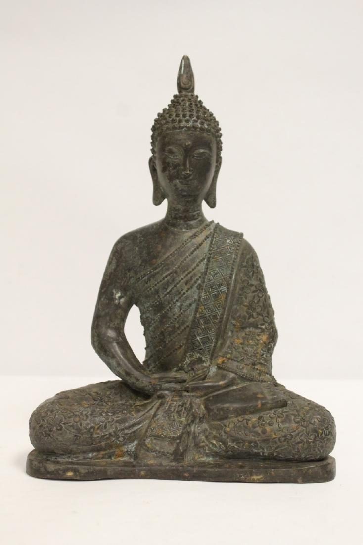 Bronze sculpture of seated Buddha
